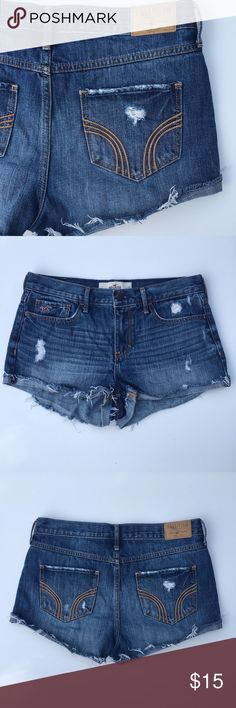 Hollister Distressed Jean Cutoff Shorts. 7. W 28. Hollister Distressed Jean Cutoff Shorts. 7. W 28. Front and back pockets. Distressed look with holes and markings. Medium/dark wash. Rolled up bottoms with unfinished hems. Button and zipper. 100% Cotton. Beltloops. Hollister Shorts Jean Shorts