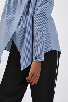 Leave shoulders bare in this super-soft off-the-shoulder top. Finished with a navy and white stripe detail and a pretty wrap back detail. #Topshop