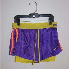 Nike dri fit shorts. Nike Pro. .....ITEM- Dri Fit athletic Shorts with built in spandex. .....CONDITION- Great. Small stain inside of shorts. Not noticeable when worn. .....STYLE- Athletic. .....COLOR- Purple and yellow. .....SIZE- XS. .....FIT- Athletic.   -----I SHIP WITHIN 24 HOURS.   -----PLEASE ASK ALL QUESTIONS PRIOR TO PURCHASING. Nike Pants