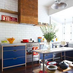 Throwback to the beginning of 2014, when we featured this personality packed kitchen by the genius team at @materialcreative. Modern navy cabinetry with ply detailing is paired with butcher's tiles, and a recycled wood rangehood cover, for a look that's contemporary, while also drawing on the homeowners passion for colour, collecting and vintage design. Photo @larnienicolson #tbt #homestyleloveskitchens #materialcreative #nzdesign #eclecticinterior Kitchen 2016, Kitchen Cart, Kitchen Cabinets, Kitchen Ideas, Rubber Flooring, Recycled Wood, Country Chic, Style At Home, Contemporary