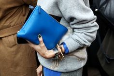 blue clutch and a stack of bracelets