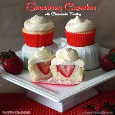 Strawberry cupcakes with an actual strawberry inside topped with cheesecake frosting! Dessert can't get much better than this!
