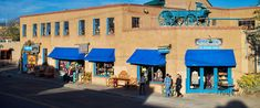 Santa Fe, NM - Double Take is a consignment store like no other, with three stories and a huge selection of world antiques, western goods, Santa Fe pottery, contemporary and vintage fashions, mainstream and designer wear, home goods, and children's items.