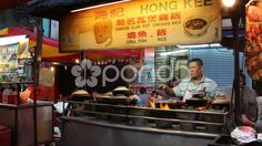 Men preparing Food at street Food both in Malaysia - Stock Footage   by JahnProductions