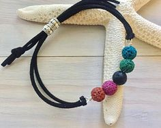 This fun wrap rainbow lava stone bracelet is the perfect everyday style for wearing your essential oils! It features lava stone beads and faux leather/suede cord in your choice of color. The bracelet features an adjustable cinch cord to fit any Leather Jewelry, Beaded Jewelry, Jewelry Bracelets, Jewelery, Handmade Jewelry, Handmade Wire, Silver Bracelets, Handmade Bracelets, Wire Jewelry
