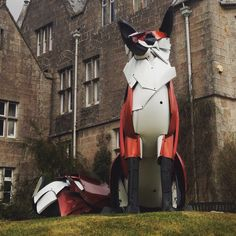 Fox sculpture made out of old car bumpers by hubcap creatures