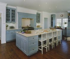 similar to my kitchen layout with doors on either side, stove int he middle and an island. Sink is in island and not under windows.