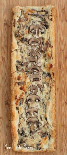 CREAMY MUSHROOM TART ~  1 sheet frozen puff pastry, thawed...2 slices bacon, chopped...2 T. minced red (or yellow) onion...1 clove garlic, minced...4 oz cremini or mini-bella mushrooms, cleaned and rough chopped + another 1 or 2 extra for garnish, thinly sliced...1 t. dry herbes de Provence...2 T. dry white wine...1/2 c. (half a small tub) light cream cheese...1/2 t. each salt and black pepper...1/3 c. shredded Mozzarella or Provolone cheese