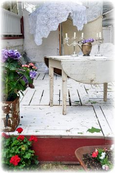 Deck made from pallets and barn wood.  I want to do this but I probably won't whitewash it.