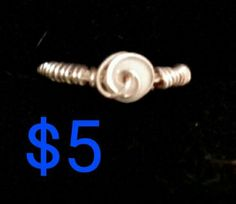 Extremely pale lavender silver wire wrapped spiral ring.