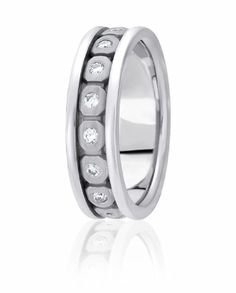 Flush Set Diamonds In Stone Finished Octagon Shaped Bezels Highlight This Stunning And Modern Eternity Style Wedding Ring
