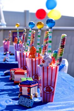 party favors; center pieces... popcorn boxes at dollar tree