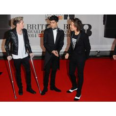 BRIT AWARDS 2014 Niall Horan limps across red carpet after arriving on... ❤ liked on Polyvore featuring one direction