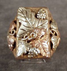 Large, Vintage Man's Black Hills Gold Ring 10k- 12k comes from the Ruby Lane Shop of Ogee's Antiques.
