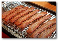 BAKING BACON.  Best thing ever!  Line baking sheet (with sides) with foil (rack is optional). Place pan in cold oven. Set temp to 400* and walk away!  Bake for 17-20 min. Done!  Drain oil, throw foil away.  No clean up!!