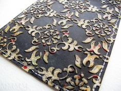 Pressure embossed, heat embossed, and ink resist techniques used for this paper (lots of photos and very detailed instructions)- looks like something I could do