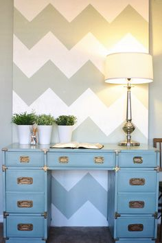 cool idea, large canvas or board as background: painted or covered in fabric? Also, I love this desk.