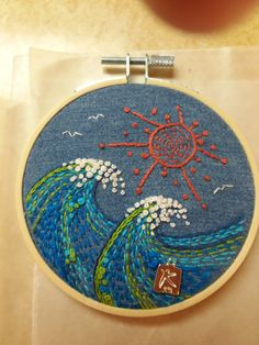 Embroidery hoop art.  Ocean art. Handstitched.  Waves and sun. On recycled chambray.