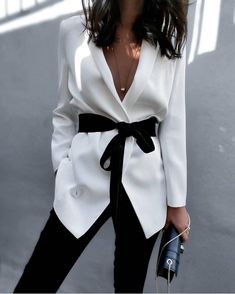 STYLE TIP: tie a black ribbon at the waist of a white blazer for a new look. Works with other colors as well
