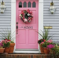 Love the color of this door and the house number decal on it. Next house I must convince husband to let me have a pink door :)