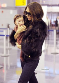 Victoria Beckham with baby Harper. Mum's know how to dress well.  Try a fur coat with a pair of skinny jeans when it cools down #mum #fashion