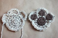 Awwww.. So cute! This paw print sewn onto a crocheted heart- like a paw print on your heart as a memento for a passed dog- so sweet