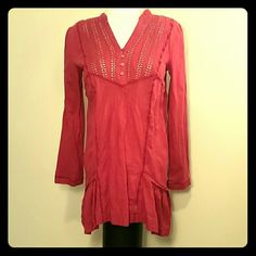 Free People Lace & Raspberry Pink Tiered Tunic Raspberry pink colored cotton tunic by Free Peoplehas V-neck has lace eyehole detail on the bodice, sides, and wrists, and 4 button front closure.  Asymmetrical being longer in back with peplum sides at hem, long sleeves. Free People Tops Tunics