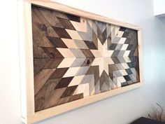 """This is a handmade wooden wall mosaic made from upcycled wood. Each piece is hand cut and arranged into this beautiful sunburst to be enjoyed for many years to come. Dimensions: approximately 24"""" x 48"""