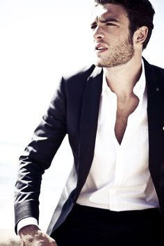 Sometimes all you need is a crisp white shirt. Note: the deep unbuttoned look is not appropriate for all men.