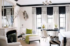 Love the window fashions. I would never have an animal head in my home, let alone a bedroom. Otherwise, great look. A New York Master Bedroom. In the master bedroom of an apartment on New York's Upper East Side designed by Brian McCarthy, the armchair upholstery and linen curtains from Quadrille are custom printed with a fernlike pattern. The ebonized-wood bed is Ralph Lauren Home, and the Art Deco side chair is from Bernd Goeckler Antiques.