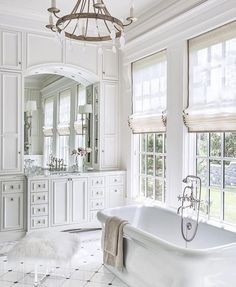 High ceilings, white paint, standing tub, gorgeous chandelier. Four simple rules to bathroom perfection. Image via @luxemagazine #kathykuohome #interiordesign #allwhite #bath #homeinspo