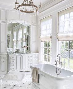 High ceilings, white paint, standing tub, gorgeous chandelier. Four simple rules to bathroom perfection. Image via @luxemagazine #kathykuohome #interiordesign #allwhite #bath #homeinspo