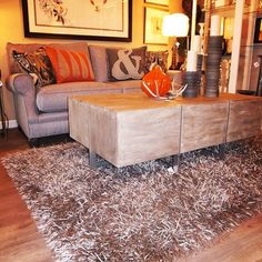 A shaggy rug and this fun cocktail table make for a fun pair. Iowa Interior Designers | Surroundings Interiors