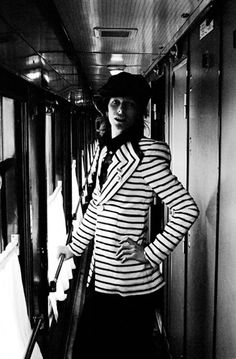 Credit: Geoff MacCormack/Rock Archive Aboard the Trans-Siberian Express. <br><br>Geoff says: 'This shot was taken early on, inside the Trans-Siberian Express. Our dress code rapidly fell away after about two days into the journey. The jacket David is wearing is a Freddie Burretti original (David's personal tailor). With his bright red hair and unconventional clothing Bowie didn't exactly blend in with the stark surroundings of Siberia/Russia.'