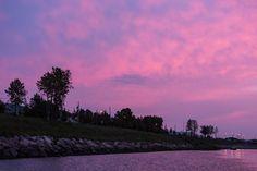 Sky before sunrise in Moosonee, looking down the Moose River. Cloudy. Moosonee shoreline.