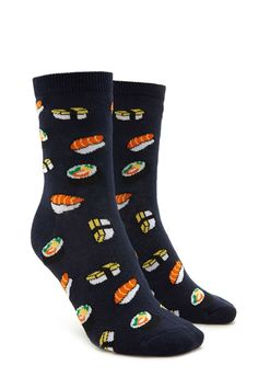 A pair of knit crew socks featuring an allover sushi print and ribbed trim.