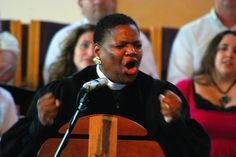 Pastor D'Mrtri Cato-Watson singing Great is Your Faithfulness at another woman's ordination.