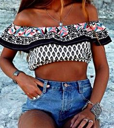 crop off shoulder top and high-waisted denim shorts