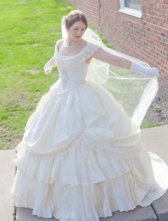 This CUSTOM MADE one-of-a-kind ornate 1860s bridal ensemble beautifully depicts an opulent era in history for both day and night outings. Whether at an indoor ball or for your own wedding, you will be the best dressed lady for miles around. This lovely 3 piece dress is created with only