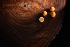 round wood slabs table detail with oranges by OSTROLUCKY