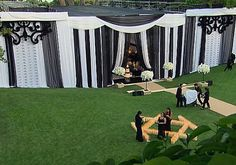 love the backdrop... Black and white curtains were draped and large arrangements of white roses lined the walkway.