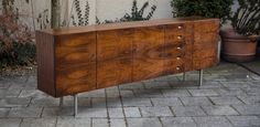 Rare Hirche Sideboard by Holzaepfel KG with label an in excellent condition.  Very fresh rosewood outside and filled with drawers and shelves in solid maple o