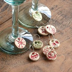 "CERAMIC WINE CHARMS, SET OF 12 -- Part of the charm of these handcrafted ceramics is that they are exclusively Sundance. Make even merrier with every glass you raise this season. Imported. Exclusive. 3 sizes, set includes four of each size. Small, 5/8"" Dia."