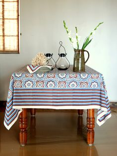 Blue Brown Moroccan Beach  TABLE CLOTHS: Use our colorful cotton tablecloths to set the mood you want to create, regardless of the occasion. So whether you are looking for colorful picnic table cloths, or something cheery for your country kitchen or even a decorative atmospheric setting for an elegant formal dinner party; this luxury cotton tablecloth is sure to add vibrant color and drama to the banquet.