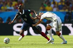 Battle: Midfielders Toni Kroos (right) and Paul Pogba (left) tussle for the ball during th...