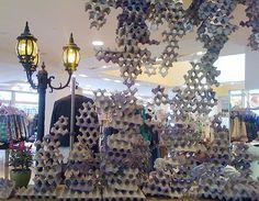 Anthropologie shop visual merchandising display installation, Egg cartons.