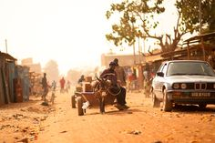 "Burkina Faso | ""Urban Donkey Cart"" by Justin Evidon // yep"