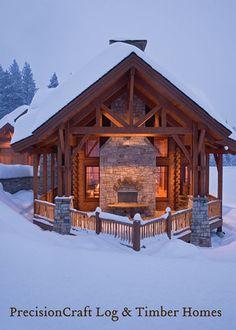 Snow covered exterior of a Timber Frame & Log Home Hybrid | by PrecisionCraft Log Homes & Timber Homes