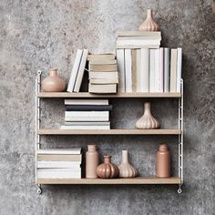 String Pocket is a lightweight shelf manufactured by the Swedish company String Furniture. String Pocket comes in fixed combinations consisting of 2 side panels and 3 shelves. String Pocket, Oak Shelves, Shelving, Shop Interior Design, Home Interior, String Regal, String Shelf, String System, Regal Design