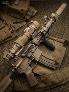 suppressed rifle by LaRue Tactical M4a1 Rifle, Assault Rifle, Assault Weapon, M4 Carbine, Military Weapons, Military Life, Military Tactics, Cool Guns, Guns And Ammo